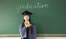 A miss graduate in classroom Royalty Free Stock Image