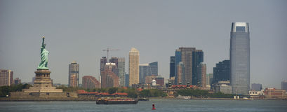 Miss liberty. Panorama of miss liberty with buildings in the background Stock Images