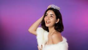 Miss Pageant Beauty Contest silver Diamond Crown. Portrait of Miss Pageant Beauty Contest in white fur Evening dress light Diamond Crown, LGBT transgender Asian royalty free stock photography