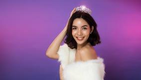 Miss Pageant Beauty Contest silver Diamond Crown. Portrait of Miss Pageant Beauty Contest in white fur Evening dress light Diamond Crown, LGBT transgender Asian royalty free stock photo