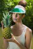 Miss Pineapple. Young lady posing with a pineapple Stock Images