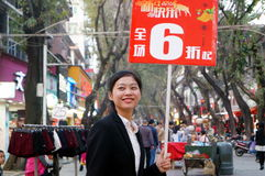 Miss promotions. Held discounted clothing brand advertising, in Shenzhen Xixiang pedestrian street, China Royalty Free Stock Images