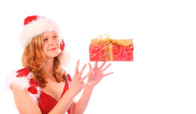 Miss Santa is Catching a Red Gift Box Royalty Free Stock Photo