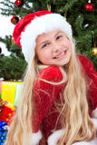 Miss santa before christmas tree and gifts Royalty Free Stock Images