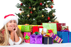 Miss santa before christmas tree and gifts Royalty Free Stock Image