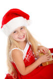 Miss santa with a gift Stock Photo