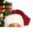 Miss santa hiding Royalty Free Stock Images