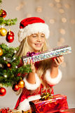 Miss santa holding a gift Stock Images