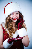 Miss Santa looking at the snow and cellular Royalty Free Stock Photography