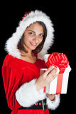 Miss Santa opening a gift box Stock Images