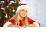 Miss santa presenting copyspace Stock Image
