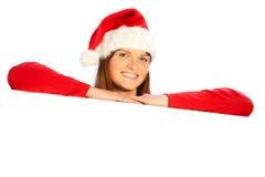 Miss santa presenting copyspace Royalty Free Stock Image