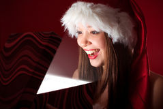 Miss Santa's opening the gift! Royalty Free Stock Photos