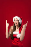 Miss Santa's showing something above her. Stock Image