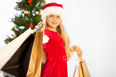 Miss santa with shopping bags Royalty Free Stock Photos
