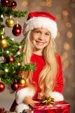 Miss santa smiling Stock Images