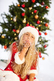 Miss santa with snow. Little miss santa playing with snow Stock Photography