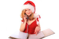 Miss Santa is Taking Orders on the Phone Royalty Free Stock Photos