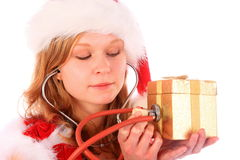 Miss Santa is Writing with a Blue Marker Pen royalty free stock photography