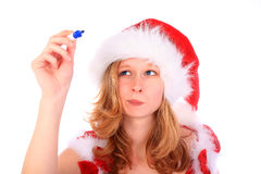 Miss Santa is Writing with a Blue Marker Pen Stock Photography