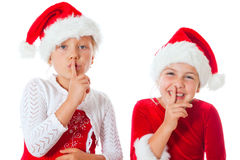 Miss santas saying be quiet. Little miss santas saying be quiet Stock Images