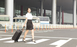 A miss staff on trip. An asian miss staff is on business trip and passing walkcross Stock Photo