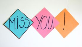 Miss you. Papers with a miss you note stock photography