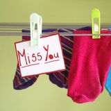 Miss you. Paper with a miss you note on a washing-line Royalty Free Stock Images