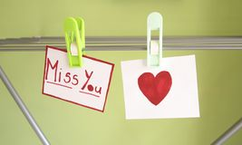 Miss you. Papers with a miss you note on a washing-line Royalty Free Stock Photography