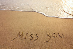Miss you. Words on the sand Royalty Free Stock Photography