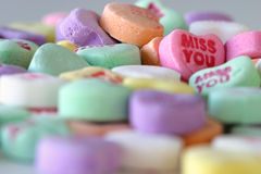 Miss you. Sweet heart candy on a table with the message MISS YOU Stock Images