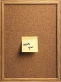 Miss you note. Color shot of a cork board with a sticky note reading miss you Stock Image