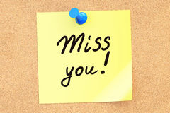 Miss You! Text on a sticky note pinned to a corkboard. 3D render Royalty Free Stock Photos