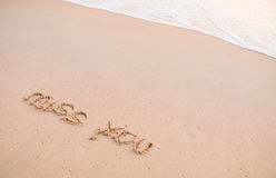 Miss you, words on the sand and moving wave Stock Photos