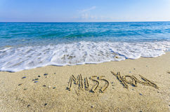 MISS YOU words written in the sand Royalty Free Stock Photo