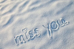 Miss you writing on the snow. Miss you with heart sign writing on the snow Stock Photo