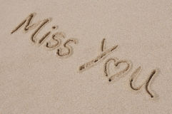 Miss You Written in Sand Royalty Free Stock Photography