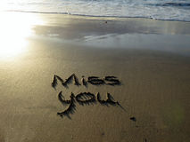 Miss you  written in sand Stock Image