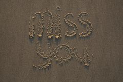 Miss You written in the sand royalty free stock photo