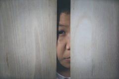 missbrukat barn Arkivfoto