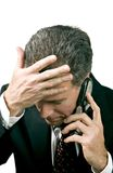 Missed Appointment. Businessman on a cell phone reacting in a distressed manner to what is being said during a phone conversation Stock Image