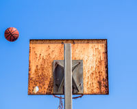 A missed Basketball shot. Against a clear blue sky royalty free stock photo