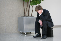 Missed Flight. A business man who missed his flight at the airport stock image