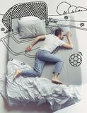 Top view photo of young man sleeping in a big white bed and his dreams stock photo