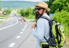 Missed his bus. Tips of experienced traveler. Man bearded hipster tourist at edge of highway. Pick me up. Traveler. Waiting for car take him anyway just to drop stock photography