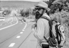 Missed his bus. Tips of experienced traveler. Man bearded hipster tourist at edge of highway. Pick me up. Traveler. Waiting for car take him anyway just to drop stock images