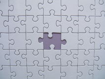 Missed jigsaw piece Stock Image