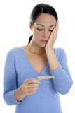 Missed pill. Woman looking shocked at her contraceptive pills Stock Photo