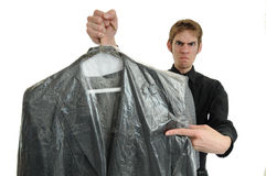 Missed A Spont. Unsatisfied customer holds up a dry cleaned suit. Missed a spot royalty free stock photo