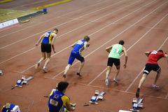 Missed start. The missed start ( person on the 5th place ) of 60m man race, picture from National juniors 1 races from 25 January in Bucharest Stock Images
